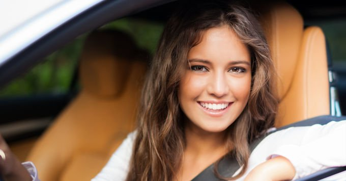 Young woman in her car